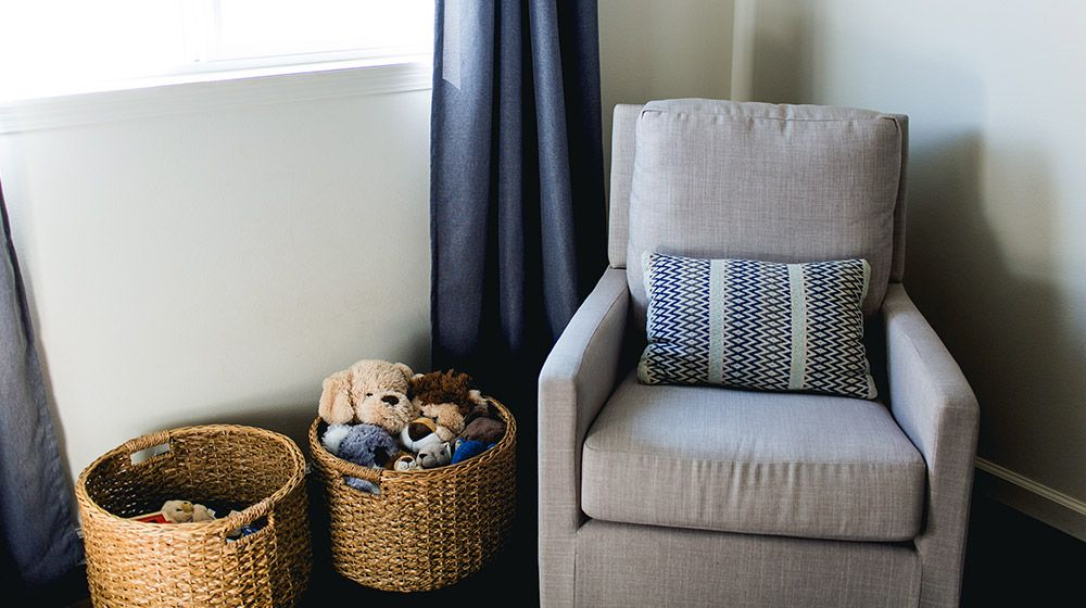 comfy glider rocking chair in a nursery room