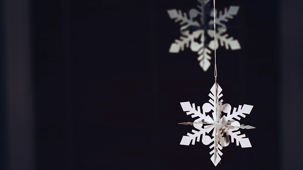 Homemade snowflake hangs in a window