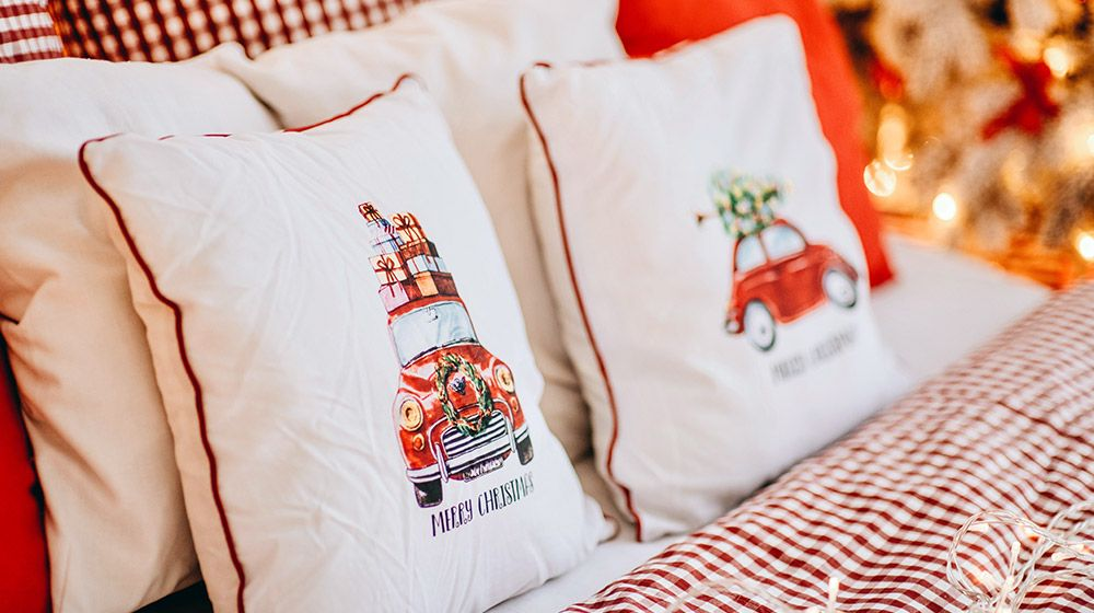 Rustic Christmas pillows in a space decorated for the holiday season