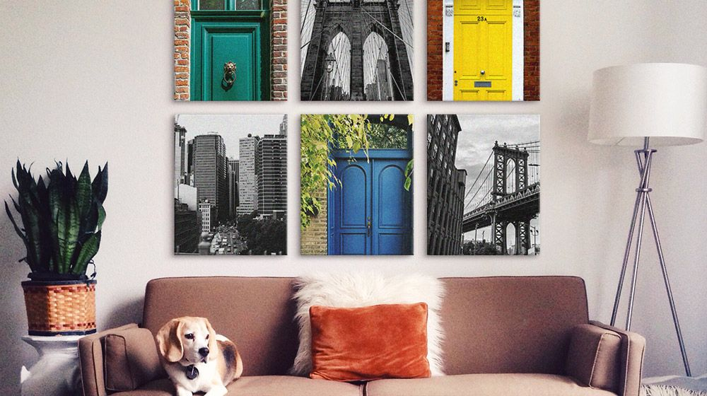 Black and white photography mixed with brightly colored prints in a living area