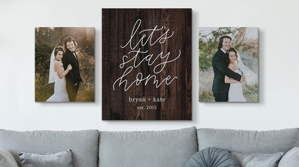 personalized word art canvas between two wedding photos on a wall