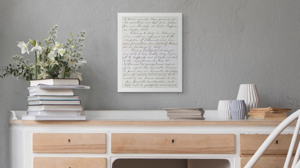 A handwritten note enlarged and print on canvas above a desk