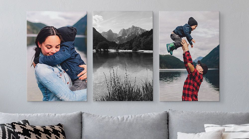 Three large canvas prints above a couch