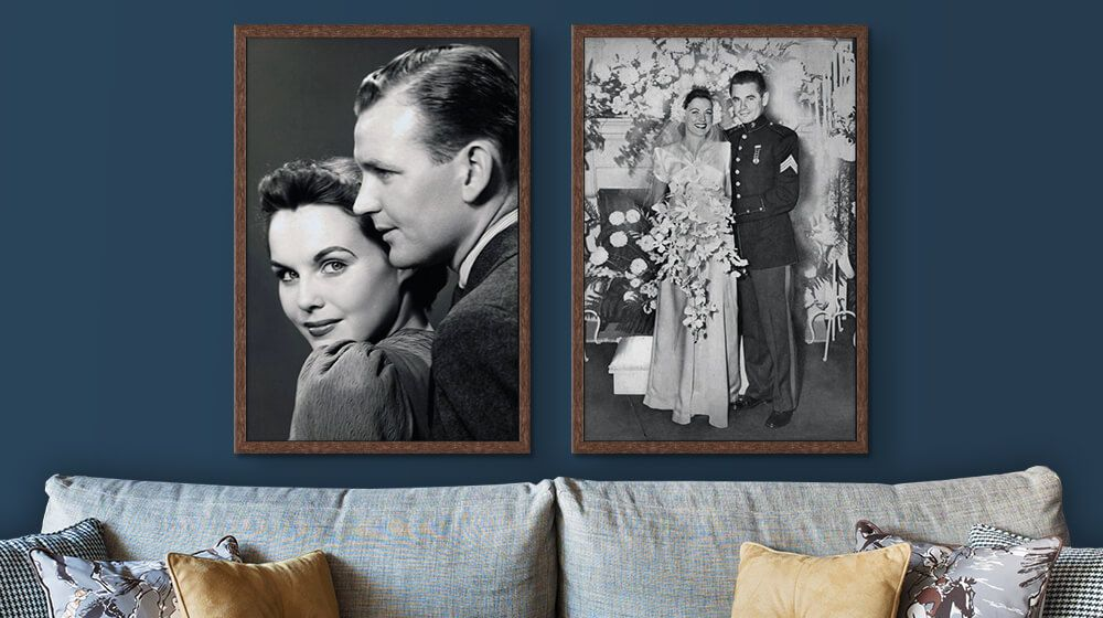 two walnut framed canvases with vintage wedding photos above couch