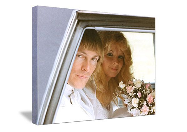 vintage photo of wedding couple with blonde hair sitting in the back of a car