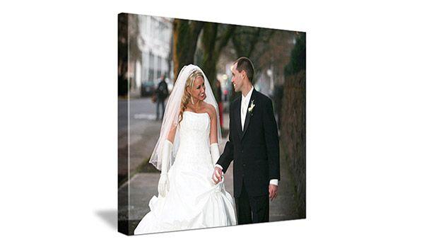 image of wedding couple walking outside underneath trees