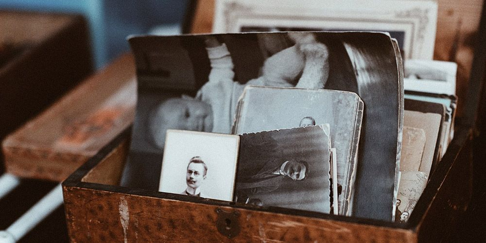 wooden box of old black and white photos