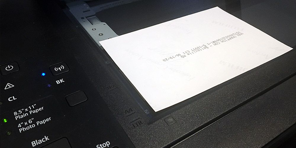 black computer scanner with photo on top