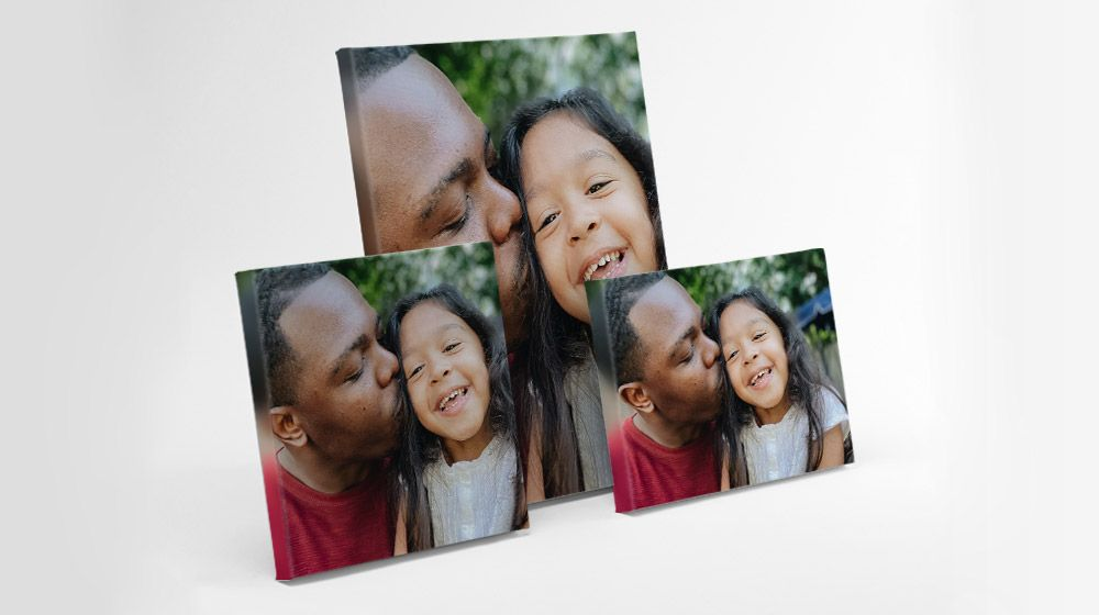 a variety of canvas sizes featuring a black dad and mixed daughter
