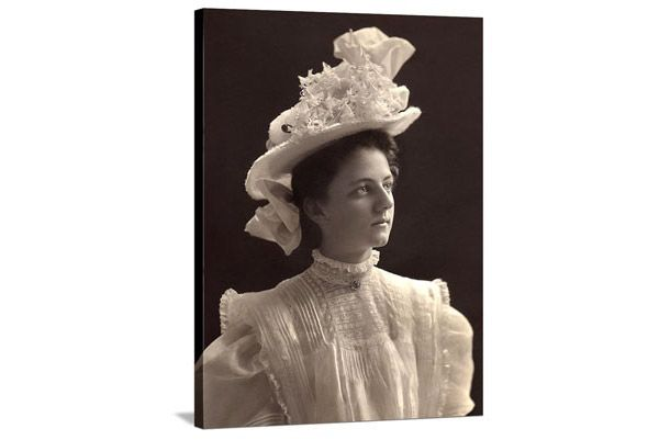 black and white image of woman in victorian dress and hat