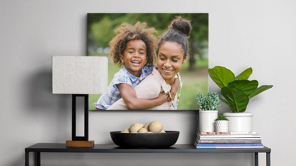 16x20 Canvas Print of a mother and child over a table in a modern entryway.