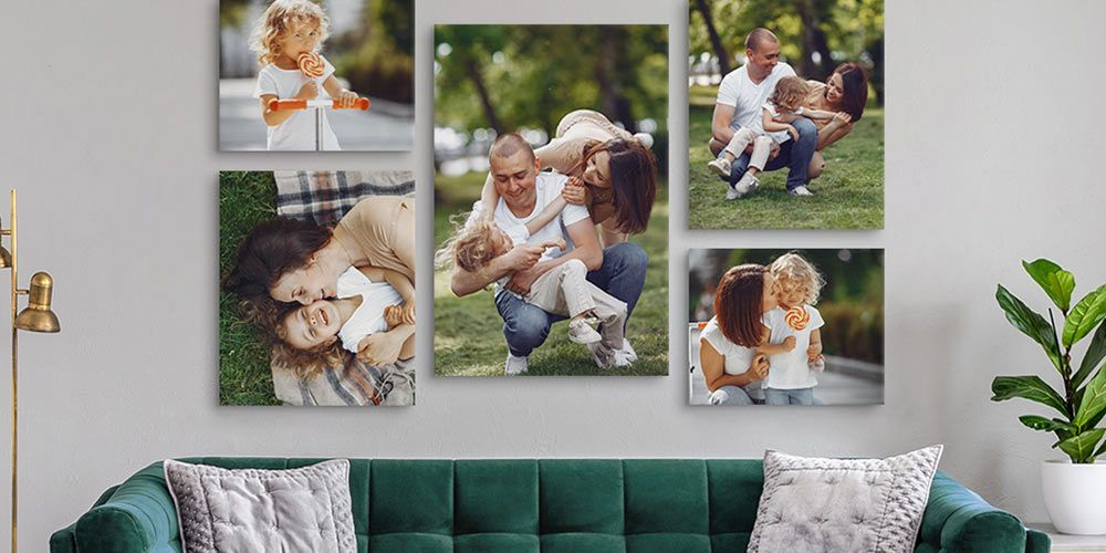 canvas wall display featuring photos of a small family in various poses hanging over a green couch in a modern living space